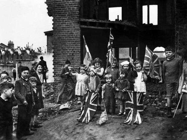 Post WWII Children holding Union Jack flags